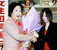 Dark horse: Mieko Yoshimura (left), who had the support of the Democratic Party of Japan, is given flowers by her daughter, Manami, in celebration of her victory in the Yamagata gubernatorial race on Jan. 25. | KYODO PHOTO