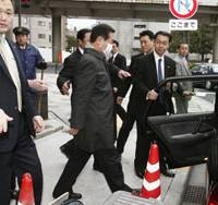Into the cold: Democratic Party of Japan President Ichiro Ozawa exits DPJ headquarters Tuesday in Tokyo's Nagata-cho district.   KYODO PHOTO