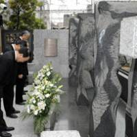 Paying their respects: Tokyo Metro Co. officials bow during a memorial service Sunday in Meguro Ward on the ninth anniversary of a fatal subway accident. | KYODO PHOTO