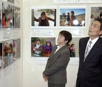Remembrance: Masayuki and Junko Ito view a photo exhibit Tuesday in Fukuoka that commemorates their aid worker son, Kazuya, who was slain in Afghanistan last year. | KYODO PHOTO