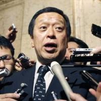 In command: Defense Minister Yasukazu Hamada speaks with reporters Friday at the Diet. | KYODO PHOTO