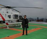 Narita super-express: Actor Tom Cruise stands in front of a helicopter on the roof of the Ark Mori Building in the Akasaka district in Minato Ward, Tokyo, on March 8. Cruise was the first passenger of Mori Building Co.'s copter transport service, which connects Narita airport and central Tokyo in just 20 minutes. | ©2008 MGM STUDIOS INC. ALL RIGHTS RESERVED