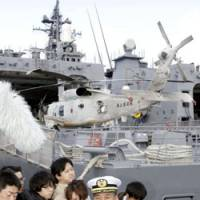 Into harm's way: Maritime Self-Defense Force Capt. Hiroshi Goto, commander of the antipiracy task force heading for Somalia, speaks to reporters Saturday before departure. | KYODO PHOTO