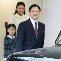Water won't wait: Prince Naruhito gets into a car at his official residence in Tokyo's Motoakasaka district Saturday to leave for Turkey, as Princess Masako and daughter Aiko look on. | POOL PHOTO