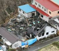Fatal blaze: The charred rubble of the Tamayura elderly care home in Shibukawa, Gunma Prefecture, is seen early Friday after an overnight fire. Seven residents were found dead at the scene. | KYODO PHOTO