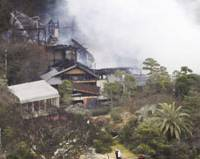 Smoke and ash: Smoldering ruins are all that's left of the residence of former Prime Minister Shigeru Yoshida, the grandfather of Prime Minister Taro Aso, in Oiso, Kanagawa Prefecture, following a fire Sunday. | KYODO PHOTO