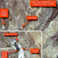 Eye in the sky: A satellite image taken Thursday by Digitalglobe shows the vehicle assembly building and launchpad for a North Korean missile facility at Musudan-Ri. The inset contains a magnified image of the launchpad.   KYODO PHOTO