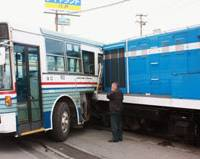 Unnatural contact: A locomotive rests against a bus at a crossing in Hachinohe, Aomori Prefecture, on Monday.   KYODO PHOTO