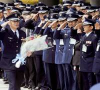 Sky's the limit: Lt. Col. Kimiya Yui, a fighter pilot retiring from the Air Self-Defense Force to become an astronaut, receives a farewell ceremony at the Defense Ministry on Tuesday.   KYODO PHOTO