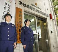 Make our day: Policewomen man a 'koban' police box Wednesday in Minato Ward, Tokyo, as the force began deploying female officers on a full-time basis. | KYODO PHOTO