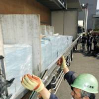 Take notice: A truck is readied to deliver public pension notices Friday in Urayasu, Chiba Prefecture.   KYODO PHOTO