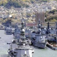 Sailing orders: The Maritime Self-Defense Force destroyers Sazanami (right) and Samidare depart from Kure, Hiroshima Prefecture, last month for a mission off Somalia to protect Japan-related vessels. | KYODO PHOTO