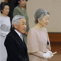 Golden moment: Emperor Akihito addresses a ceremony Friday at the Imperial Palace in Tokyo to fete his 50th anniversary with Empress Michiko.   KYODO PHOTO