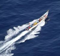 One that got away: A high-speed boat carrying suspected pirates is photographed by a Maritime Self-Defense Force helicopter Saturday afternoon off Somalia.   COURTESY OF MSDF / KYODO PHOTO
