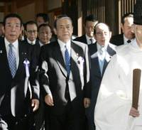 Rank and file: Lower House Representative Yoshinobu Shimamura (center) and other lawmakers are led by a Shinto priest to the main altar of Yasukuni Shrine in Chiyoda Ward, Tokyo, on Wednesday.   KYODO PHOTO