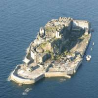 No longer off-limits: Tourists are now able to visit Hashima Island, better known as Gunkanjima, or Warship Island, as a 35-year-old landing ban was lifted Wednesday. Decaying structures on the island include apartments once inhabited by miners and their families. | KYODO PHOTO/COURTESY OF NAGASAKI MUNICIPAL GOVERNMENT