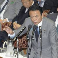 Under attack: Prime Minister Taro Aso attends a Diet session Thursday. Chinese media have accused him of trying to portray Beijing as a nuclear threat to gain domestic support. | KYODO PHOTO