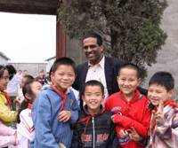 Proactive: Soma Somasundaram, chairman of Professionals for Children (PfC), is surrounded by schoolchildren during a visit to China's Sichuan Province earlier this year.   COURTESY OF PFC