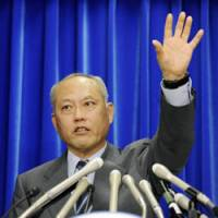 On alert: Health minister Yoichi Masuzoe announces the nation's first confirmed cases of swine flu early Saturday. | KYODO PHOTO