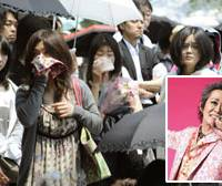 Final farewell: Fans of late rock singer Kiyoshiro Imawano (inset) gather at Aoyama Sogisho funeral hall Saturday to mourn his death May 2. | KYODO PHOTO
