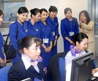In-flight service: Taiwanese interpreters (standing) who can speak Taiwanese, Mandarin and English receive guidance Wednesday at the office of All Nippon Airways at Tokyo's Haneda airport. | KYODO PHOTO