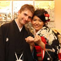 Hand in hand: Aiko Tanaka, 27, an elementary school teacher, and Olegs Orlovs, 27, a Latvian diplomat, pose for a wedding photo in Tokyo in 2008. | COURTESY OF OLEGS ORLOVS AND AIKO TANAKA
