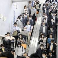 On guard: Many commuters wear masks at JR Sannomiya Station in Kobe on Monday as the Kansai region saw a spike in swine flu cases. | KYODO PHOTO