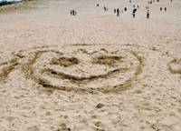 Drawing a line: A huge face was carved in the sand at the Tottori Dunes in April.   KYODO PHOTO
