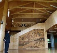 Auctioned off: A visitor on Tuesday takes a look inside the closed Taiyo Elementary School in Niikappu, Hokkaido, which found a buyer online for 30 million yen. | KYODO PHOTO