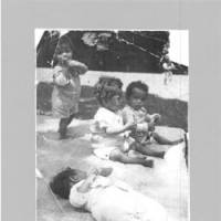 Recovery days: Demian Akhan (seated, far right) plays on the lawn outside the Elizabeth Saunders Home, an orphanage for mixed-blood babies in Kanagawa Prefecture, in this photo taken by his adoptive parents in 1949. | COURTESY OF DEMIAN AKHAN