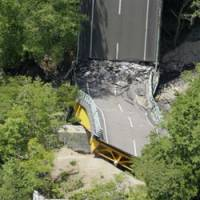 Try another route: Matsurube Bridge in Ichinoseki, Iwate Prefecture, destroyed by a major earthquake last June 14, is photographed from a helicopter last week. | KYODO PHOTO