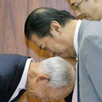 Dispensing protocol: Internal affairs minister Kunio Hatoyama (right) and Japan Post Holding Co. President Yoshifumi Nishikawa acknowledge each other Tuesday before the start of an Upper House committee session. | KYODO PHOTO