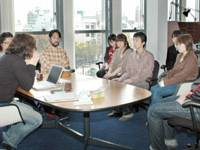 Getting away from it all: Employees at Tokyo-based ufotable Inc. hold a meeting at the firm's new animation studio in Tokushima on April 1. | KYODO PHOTO