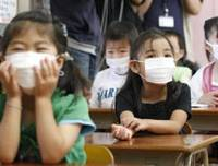 Who giggled?: Children listen Monday to a teacher at a Fukuoka elementary school as lessons resumed after the school was closed due to the swine flu outbreak. | KYODO PHOTO