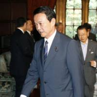 Business as usual: Prime Minister Taro Aso heads to a Cabinet meeting Tuesday morning. | KYODO PHOTO