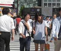 Waking up?: People use a crosswalk in Tokyo's Shibuya Ward, a downtown shopping area usually jammed with young people, on July 4, 2008. | YOSHIAKI MIURA PHOTO