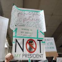 Making themselves heard: Iranians in Japan hold a rally Saturday near the Iranian Embassy in Tokyo to protest the outcome of the Iranian presidential election. | YOSHIAKI MIURA PHOTO