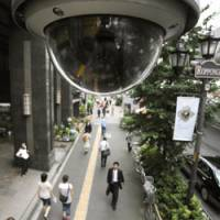Coming to a street near you: A surveillance camera hangs over a street in the Roppongi district in Tokyo. The National Police Agency said Thursday police will set up security cameras in 15 residential areas in 14 prefectures. | KYODO PHOTO