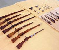 Arms cache: Weapons purchased by a Miyazaki man in alleged violation of the Firearm and Sword Control Law are displayed by police Wednesday in Nishinomiya, Hyogo Prefecture. | KYODO PHOTO