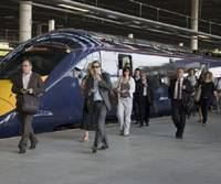 In like a bullet: Commuters at St. Pancras International Station in London disembark from a Hitachi-built Javelin train following its inaugural run into the British capital Monday. | KYODO PHOTO