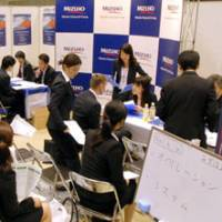 Double the pressure: Recruiters interview bilingual students at Tokyo Summer Career Forum in Tokyo Big Sight on Tuesday. | YOSHIAKI MIURA PHOTO