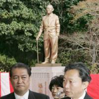 Family tradition: Yukio Hatoyama (right) and his brother, Kunio, talk to reporters in front of a statue of their grandfather and former Prime Minister Ichiro Hatoyama at Hatoyama Hall in Bunkyo Ward, Tokyo, in February 2007.   KYODO PHOTO