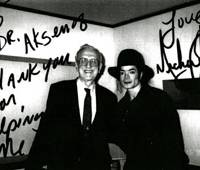 Demanding patient: Dr. Eugene Aksenoff and Michael Jackson appear in this signed photograph taken in Jackson's suite at Capitol Tokyu Hotel in Chiyoda Ward, Tokyo, in 2000. | COURTESY OF EUGENE AKSENOFF