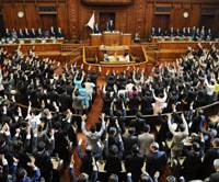 Who will be back?: Members of the Lower House shout 'banzai' Tuesday afternoon as the chamber is dissolved. | KYODO PHOTO
