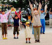 Radio days: People work out in the morning at a park in Edogawa Ward. Tokyo. The photo was taken by Hideo Ikeda, who won the grand prize in a radio exercise photo competition in 2008. | COURTESY OF NATIONAL RADIO EXERCISE FEDERATION