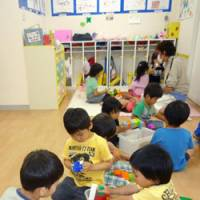 Parties wave flag for child-rearing