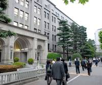 The buck stops here: People pass the Finance Ministry in Tokyo's Kasumigaseki district, the center of the bureaucracy, in June. | YOSHIAKI MIURA PHOTO