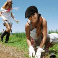 Country 'gyaru': Young female entrepreneur Shiho Fujita (right) plants herbs around her rice paddy recently in the village of Ogata, Akita Prefecture. | KYODO PHOTO