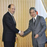 New kid on the block: U.S. Ambassador John Roos is greeted by Vice Foreign Minister Mitoji Yabunaka at the Foreign Ministry on Thursday. | KYODO PHOTO