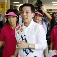 On the run: Liberal Democratic Party heavyweight Makoto Koga kicks off his election campaign Aug. 18 in his stronghold of Omuta, Fukuoka Prefecture. | KYODO PHOTO